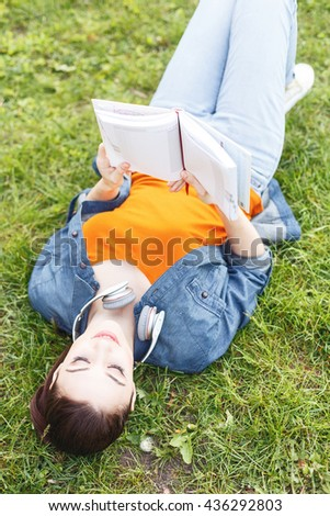 Cheerful girl is relaxing in park - stock photo