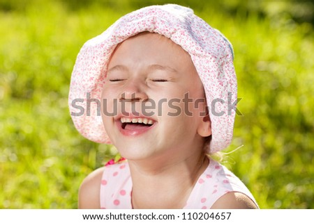 Cheerful girl laughing in the summer panama - stock photo
