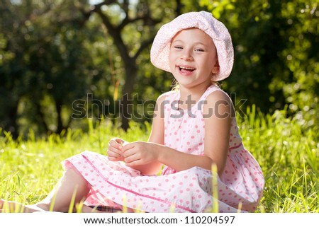 Cheerful girl laughing in the summer pink dress - stock photo