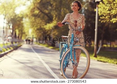 cheerful girl on a bicycle movement - stock photo