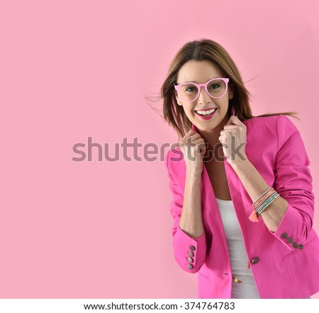 Cheerful girl wearing eyeglasses, pink color - stock photo