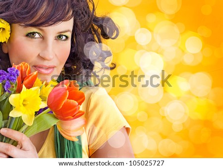 cheerful girl with a bouquet of colorful flowers - stock photo