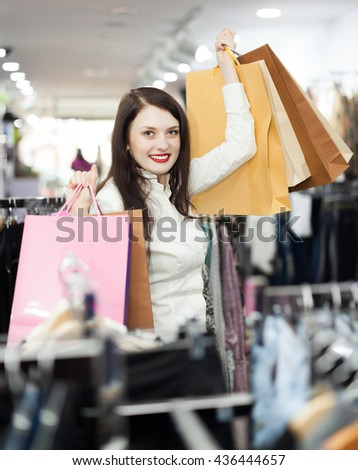 cheerful girl   with shopping bags  at clothing  store - stock photo