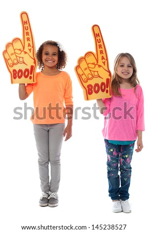 Cheerful girls each wearing big foam hand - stock photo