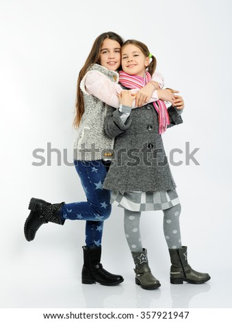 cheerful girls in a winter clothes - stock photo