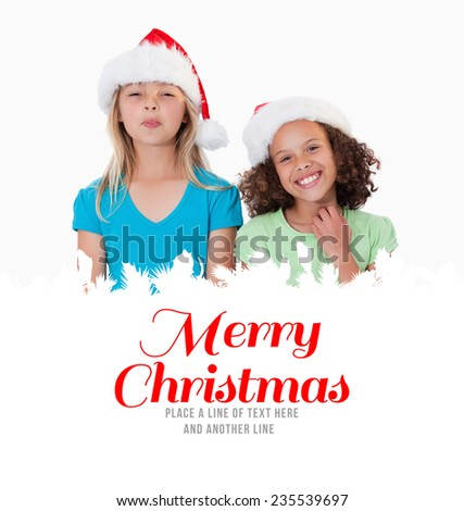 Cheerful girls with Christmas hats against merry christmas - stock photo