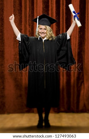 Cheerful graduated girl with mortarboard and diploma - stock photo