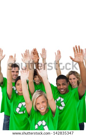 Cheerful group of environmental activists raising arms on white background - stock photo