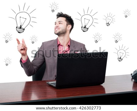 Cheerful handsome businessman solving a problem and looking happy in his office with drawn lightbulbs - stock photo