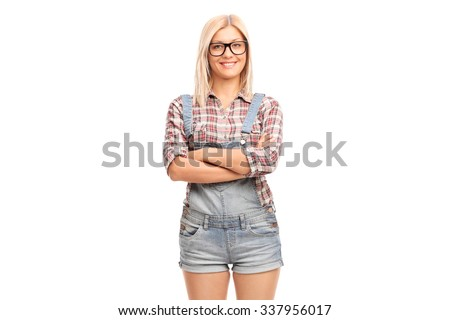 Cheerful hipster girl with black glasses and a short overalls isolated on white background - stock photo