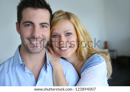 Cheerful in love couple at home - stock photo