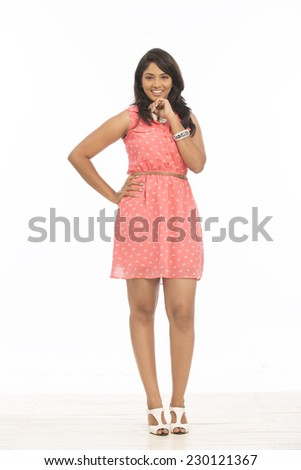 cheerful Indian young women in casual on white. - stock photo