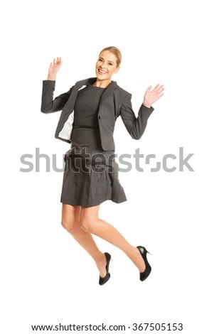 Cheerful jumping businesswoman - stock photo