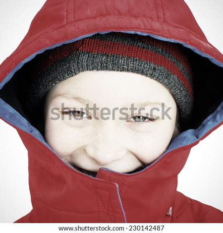Cheerful Kid Portrait in the Winter on the White Background closeup - stock photo