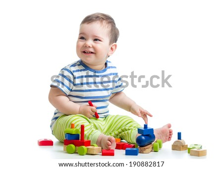 cheerful kid with construction set isolated on white background - stock photo