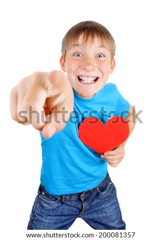 Cheerful Kid with Red Heart Shape pointing at You on the White Background - stock photo