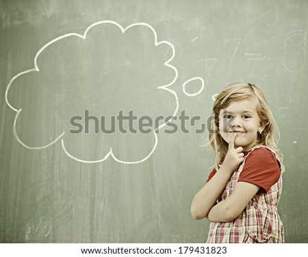 Cheerful kids at school room having education activity on chalkboard - stock photo