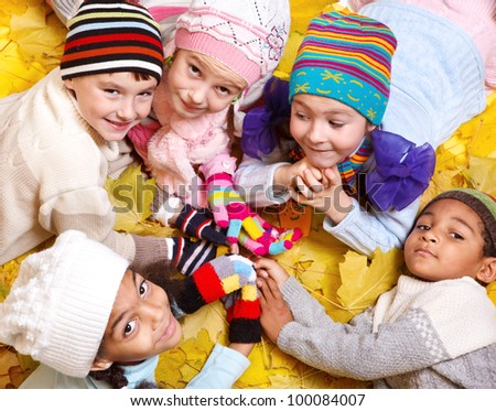 Cheerful kids in scarves and hats - stock photo