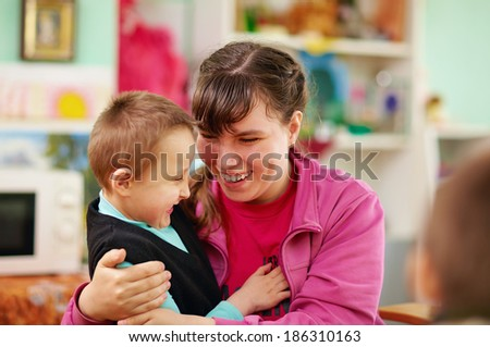 cheerful kids with disabilities in rehabilitation center - stock photo