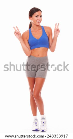 Cheerful latin lady in sport clothing standing against white background - copyspace - stock photo