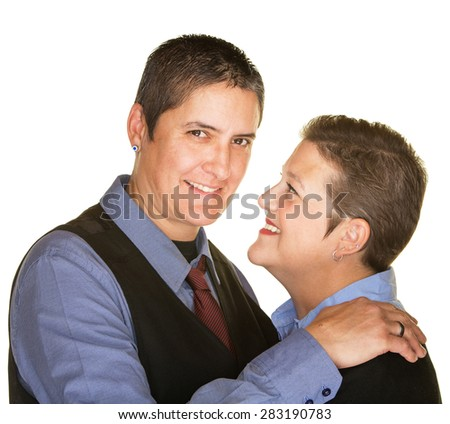 Cheerful lesbian couple embracing over isolated background - stock photo