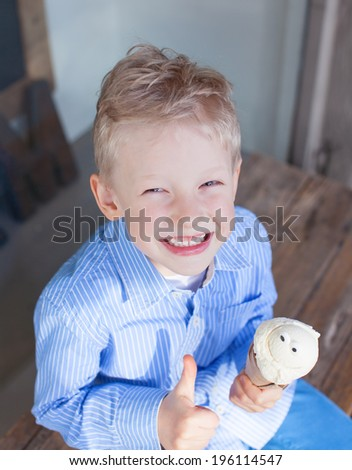cheerful little boy eating ice-cream - stock photo