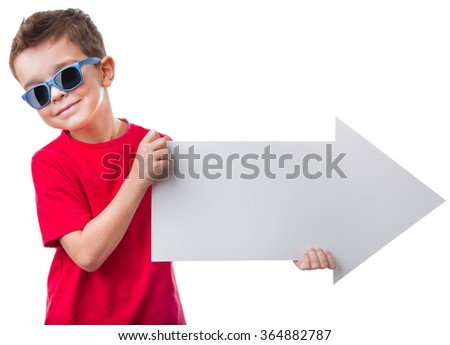 Cheerful little boy in sunglasses holding a big empty white arrow and looking at camera, isolated on white background - stock photo
