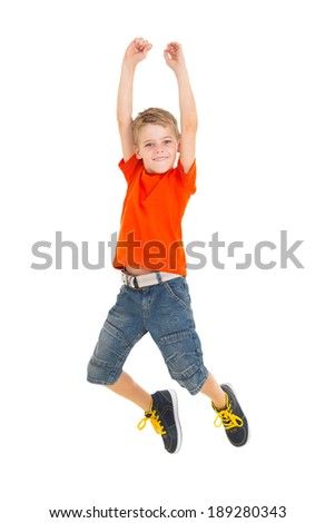 cheerful little boy jumping on white background - stock photo