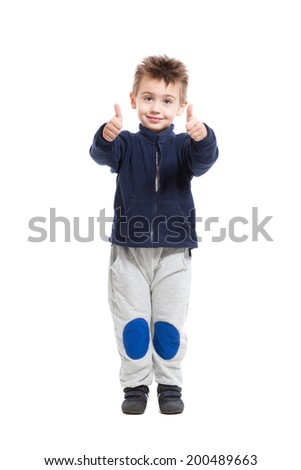 Cheerful little boy posing in sport clothes. Isolated on white - stock photo