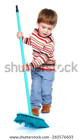 cheerful little boy sweeping the floor with a brush - isolated on white. - stock photo