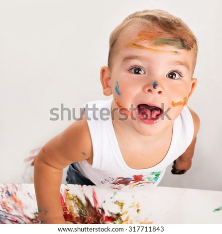 cheerful little boy with painted face portrait - stock photo