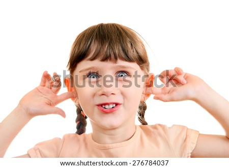 Cheerful Little Girl close the Ears Isolated on the White Background - stock photo