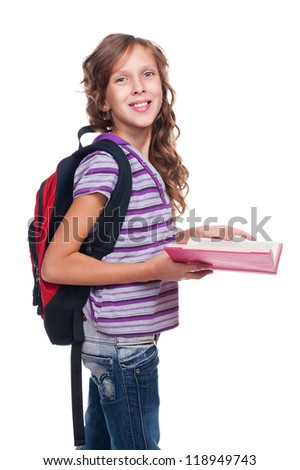 cheerful little girl holding book and looking at camera. isolated on white background - stock photo
