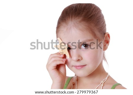 Cheerful little girl holds little star fish isolated over white background - stock photo