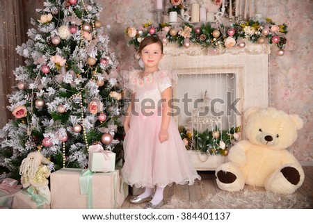 Cheerful little girl in a New Year's dress - stock photo