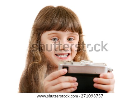 Cheerful Little Girl make a Selfie with Retro Photo Camera on the White Background - stock photo