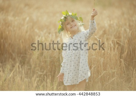 cheerful little girl on the nature of soft light portrait - stock photo