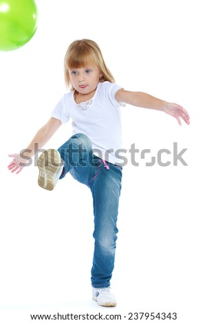 cheerful little girl playing.Isolated on white background. - stock photo