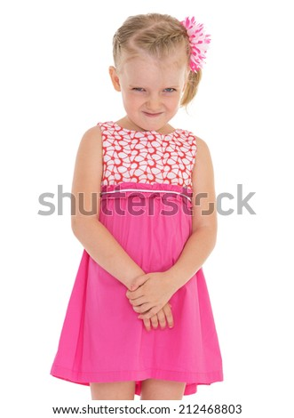 Cheerful little girl smiling on a white background.The concept of child development, education, recreation - stock photo