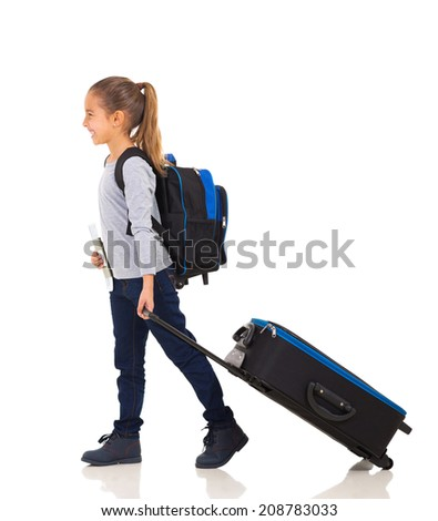 cheerful little girl walking with luggage and passport isolated on white - stock photo
