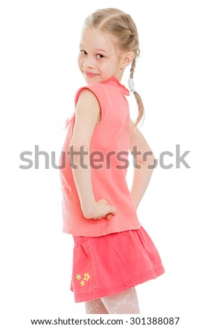 Cheerful little girl with braided hair in a pigtail stands sideways camera smiling. A girl dressed in a pink shirt and a pink short skirt. Close-up-Isolated on white background - stock photo