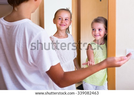 Cheerful little guests coming with friendly visit indoors - stock photo