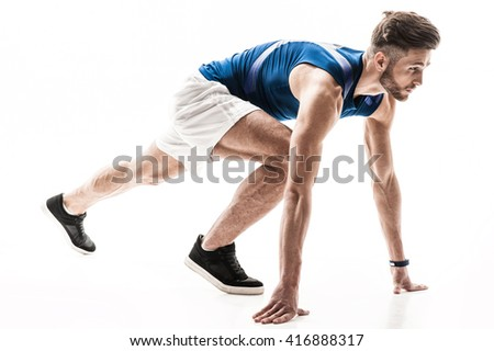 Cheerful male jogger is ready to run - stock photo