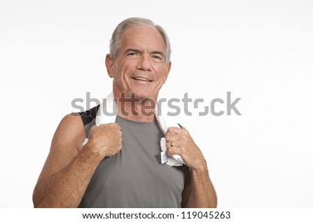 Cheerful male smiles after workout - stock photo