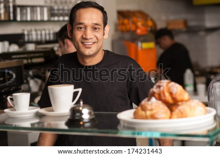 Cheerful male staff at your service - stock photo