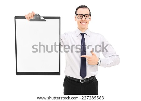 Cheerful man holding a clipboard and pointing towards it with his finger isolated on white background - stock photo