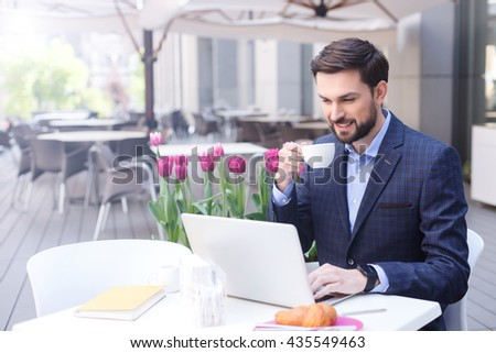 Cheerful man in suit resting in cafe - stock photo