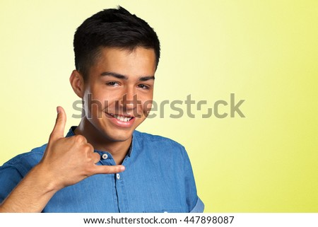 Cheerful man is making give me a call sign - stock photo