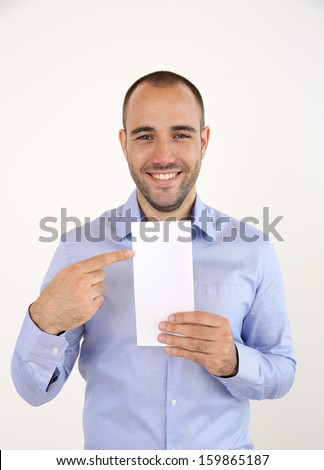 Cheerful man with blue shirt holding booklet - stock photo