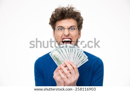 Cheerful man with glasses holding money over white background - stock photo